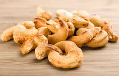 A handful of roasted cashew nuts on wood background Stock Photos