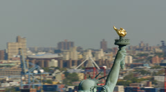 Aerial shot of Ellis Island and Statue of Liberty - stock footage
