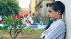 sad and unhappy child in the park - stock footage