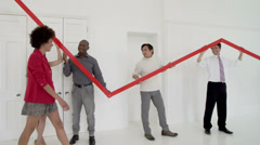 A profit / loss arrow displayed by business people in a large corporate office. Stock Footage