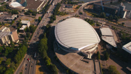 Stock Video Footage of Wide aerial shot of the Rose Garden Arena, tilt up revealing Downtown Portland