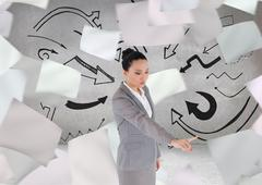 Stock Illustration of Composite image of unsmiling asian businesswoman pointing