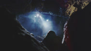 Stock Video Footage of Scientists and miners exploring dark caves.  Geologists, explorers, adventurers,
