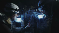 Scientists discovers insects in the dark. Miners exploring dark caves.  Stock Footage