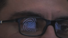 Reflection on the glasses. Man mesmerized by the computer Stock Footage