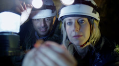 Scientist discovers insects in the dark. Miners exploring dark caves.  Stock Footage