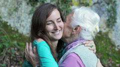 Grandmother kiss her granddaughter  Stock Footage