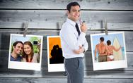 Stock Illustration of Composite image of smiling businessman holding glasses