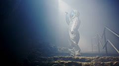 Space science fiction. An Astronaut (or Alien) in dark cave structure. A fantasy Stock Footage