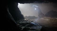 Explorer enters cave looking for treasure - stock footage
