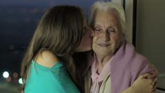 Granddaughter  kiss her grandmother - stock footage