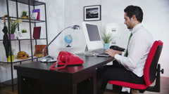 Businessman breaking office computer under pressure and stress Stock Footage