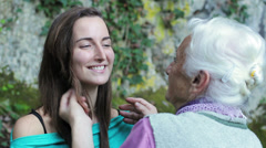 Grandmother and granddaughter in an affectionate lifestyle portrait Stock Footage