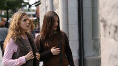 Two young women window shopping Stock Footage