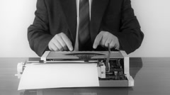 Man typing on a manual typewriter Stock Footage