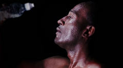 Slow motion masculine sportsman pouring water over his face. Shot on RED Epic at - stock footage