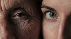 Old and young eyes - Young vs old Stock Footage