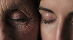 old and young eyes - Women portrait with grandmother and daughter -  open eyes - stock footage