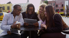 Group of friends looking at digital tablet together - stock footage