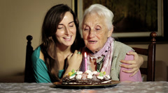 Happy smiling grandmother celebrating and giving a birthday cake to her grandson Stock Footage