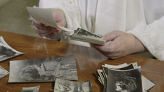 Recollections of his youth at old photographs Stock Footage