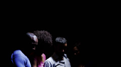 Group of people looking up against a black background. - stock footage