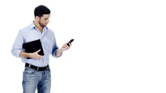 Man with digital tablet and cell phone technology on white background Stock Footage