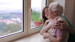 Portrait of happy grandmother with granddoughter hugging - stock footage