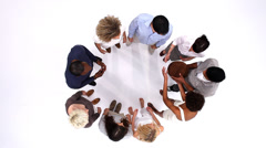 Diverse group of young adults in a circle, playing with a ball. Shot from above Stock Footage