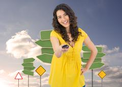 Composite image of smiling curly haired pretty woman changing channel with Stock Illustration
