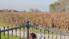 Kid playing in his country house Stock Footage