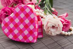 pink heart box with pearls and flowers - stock photo