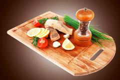 Savory sea fish entree : roasted salmon fillet with green onion Stock Photos