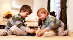 Young boys stacks play bricks until they collapse. - stock footage