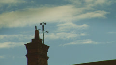 Weather vane against a pale blue sky gives indication that there's a storm a - stock footage