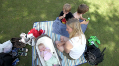 Family resting in the park - Innocent summer scene with family in natural park Stock Footage