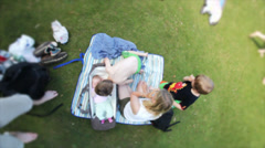 Family resting in the park - Innocent summer scene with family in natural park - stock footage
