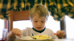 Young boy eating cereal for breakfast. High quality HD video footage Stock Footage