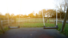 Empty swings in a play ground Stock Footage