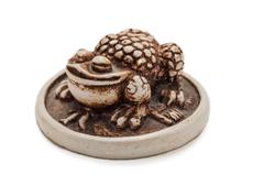 netsuke toad on a gold coin - stock photo