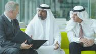 Middle eastern businessmen meeting western man Stock Footage