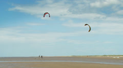 Kitesurfer enjoying his sport at the beach on a clear bright day. High quality Stock Footage