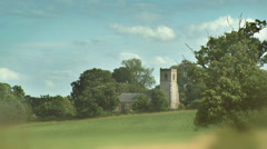 Time lapse of rolling clouds above castle in the British Countryside Stock Footage