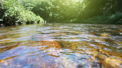 Rippling water and currents of a flowing river in HD. - stock footage