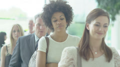 Holiday tourists queuing for their travel departure Stock Footage