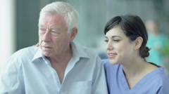 Man being comforted by caring nurses.  Assisting people when life throws - stock footage