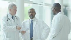 Group of doctors. Multiracial male doctors in hospital. - stock footage