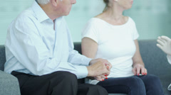 Selective focus as the camera pans from couples hands to patient to doctor and - stock footage