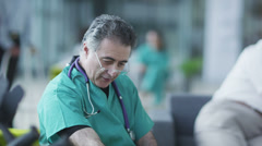 Woman comforted by caring medical staff. Assisting people when life throws Stock Footage