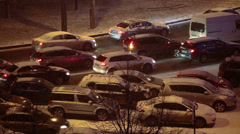 Logjam cars on the road in the evening during a snowfall Stock Footage